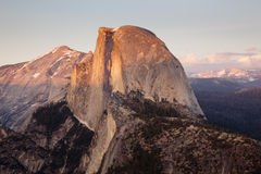 Sunset over Half Dome. Yosemite Valley with Half Dome in the setting sun royalty free stock photo