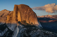 Sunset over Half Dome. Setting sun illuminating the top of Half Dome, Yosemite National Park, USA Stock Image