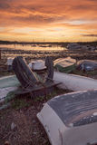 Sunset over the Hamble. Sunset over the River Hamble with dinghies and an anchor in the foreground Royalty Free Stock Image