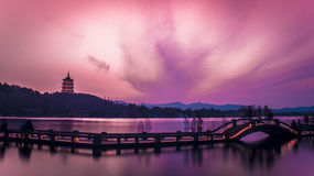 Sunset over Hangzhou West Lake, China. A long exposure of the West Lake in Hangzhou, China at sunset, dying the sky in different tones of beautiful pinks and stock photography