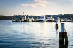 Sunset over a Harbor along the Connecticut River. In Autumn. Mooring Posts are in Foreground. Essex, CT Stock Image