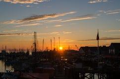 Sunset over the harbor of Steveston. Tramonto sul porto di Steveston a Vancouver in Canada Stock Photos