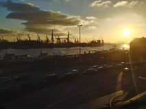 Sunset over a harbour and docks Stock Photo