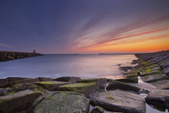 Sunset over harbour entrance in The Netherlands stock photos