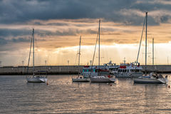Sunset over harbour with sailing yachts in Santa Margherita Ligure town, Italy Stock Photography
