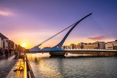 Dublin, Ireland. Sunset over harp shaped Samuel Beckett Bridge over Liffey river in Dublin, Ireland Stock Photos