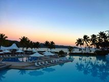 Sunset over Hayman Island Resort blue water clear skies Queensland Australia. Hayman island resort at stock images