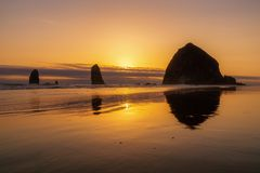 Sunset over the Haystack Rock royalty free stock photography
