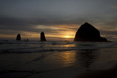 Sunset over Haystack Rock in Cannon Beach Royalty Free Stock Images