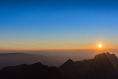 Sunset over high mountain in thailand. Sunset over high mountain in north of thailand Royalty Free Stock Image