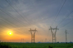 Sunset over High-voltage power lines Stock Image