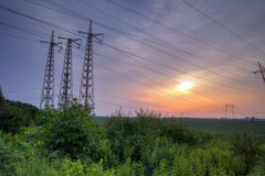 Sunset over High-voltage power lines Royalty Free Stock Image