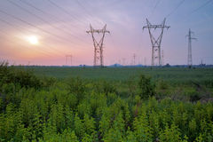 Sunset over High-voltage power lines Stock Photos