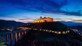 Sunset over the highlighted castle in Spoleto, Italy royalty free stock images