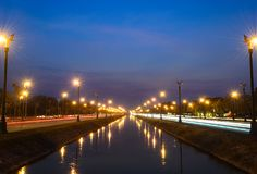 Sunset over a highway Utthayan Road and reflection on the river. royalty free stock photo
