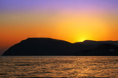 Sunset over the hill. Sunset behind the mountain, the Golden sky Royalty Free Stock Images