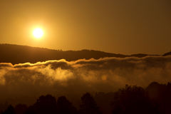 Sunset over the hill in the mountains Royalty Free Stock Photo