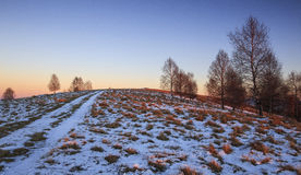 Sunset over the hill. Sunset over the snowy hill in Transylvania Stock Photos