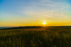 Sunset over a hill to the country Royalty Free Stock Photography