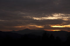 Sunset over hills. Cloudy sunset over hills from Breaza, Romania royalty free stock photography