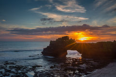 Sunset over hindu temple Pura Tanah Lot,  Indonesia Royalty Free Stock Photography