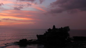 Sunset over hindu temple Tanah Lot, Bali stock video footage