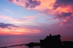 Sunset over hindu temple Tanah Lot, Bali Stock Images
