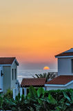 Sunset over holiday beach villas Stock Images