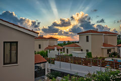 Sunset over holiday beach villas Stock Photos