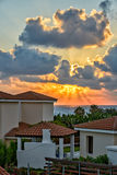 Sunset over holiday beach villas Royalty Free Stock Image