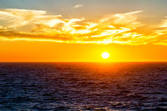 Sunset over horizon at ocean Royalty Free Stock Photography