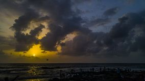 Sunset over the horizon. People coming to witness the amazing senset at the bandra fort in mumbai city Royalty Free Stock Photos