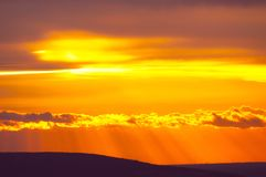 Sunset over horizon. Sunbeams over the horizon lines Royalty Free Stock Photography