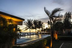 Sunset over  hotel pool. Stock Images