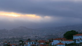 Sunset over houses from hill in Funchal, Madeira stock footage