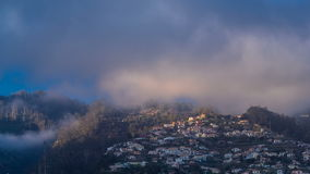 Sunset over houses on hill in Funchal, Madeira stock footage