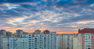Sunset over the housing estate with modern apartment buildings Royalty Free Stock Image