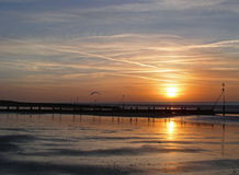Sunset over Hunstanton Beach. Sunset at low tide on Hunstanton Beach in Norfolk, UK. With a paraglider in the distance Royalty Free Stock Photo