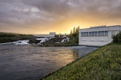 Sunset over Hydro electric powerplant stock photography