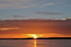 Sunset over the ice on Stadsfjärden in Luleå Stock Photography