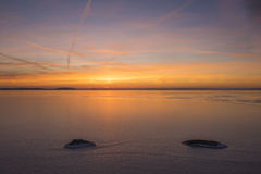Sunset over a icey lake Royalty Free Stock Photo