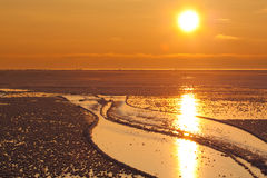 Sunset over icy sea Royalty Free Stock Photos