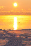 Sunset over icy sea Stock Image