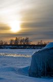 Sunset over  icy shore. Royalty Free Stock Photography