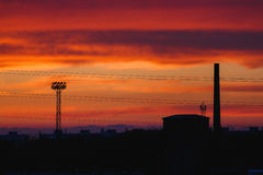 Sunset over industrial area Stock Image