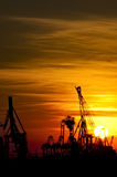 Sunset over industrial harbor Royalty Free Stock Photo