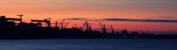 Sunset over industrial port Royalty Free Stock Image