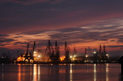 Sunset over an industry harbor with cranes in Bulgaria, Varna Stock Images