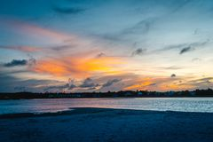 Sandy Sunsets in Pawley`s Island. Sunset over a inlet between Pawley`s Island and Litchfield beach Stock Photos