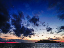 Sunset over island Royalty Free Stock Photo
